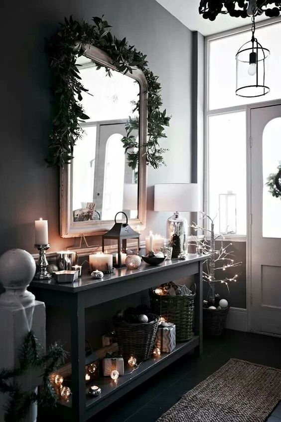 decorate your entryway in moody colors and spruce the decor with lots of candles and lights