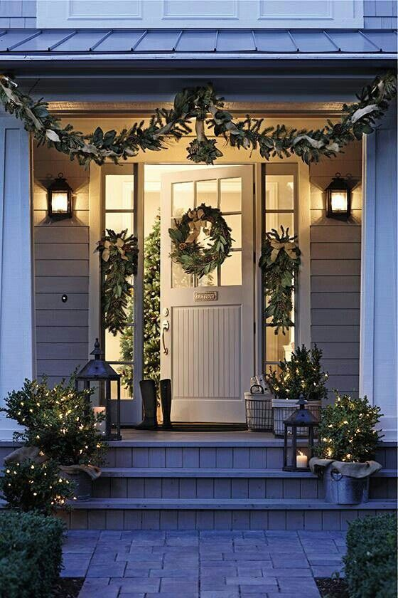 natural evergreen garlands, wreaths and trees with lights