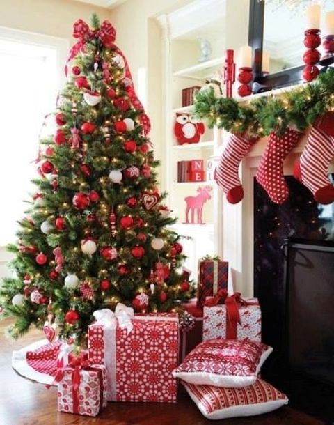 red and white ornaments, gifts and stockings