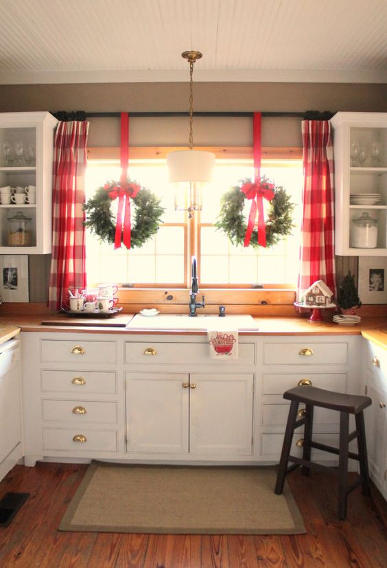 red plaid curtains and wreaths with red bows