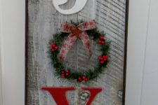 16 weathered wooden JOY sign with a small wreath