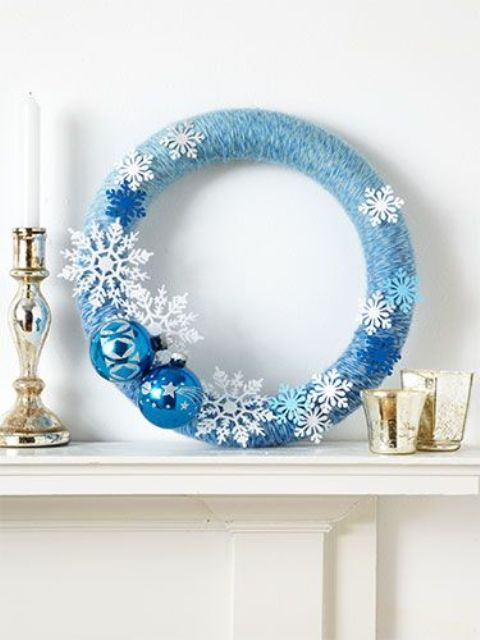 a blue an white Christmas wreath with snowflakes and ornaments
