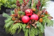 17 a large urn, evergreens, pinecones, berries, leaves and oversized ornaments