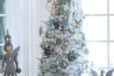 17 a silver tree with metallic ornaments