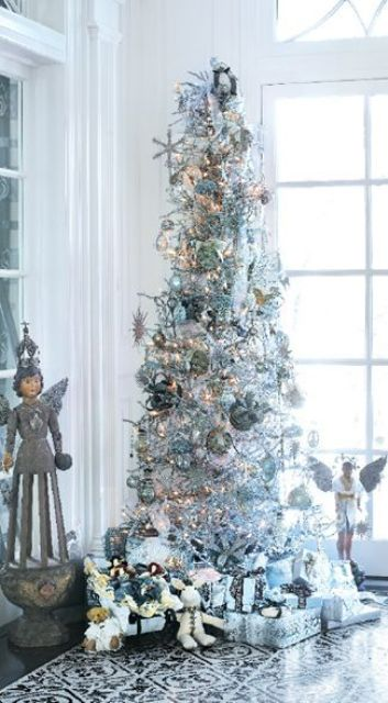 a silver tree with metallic ornaments