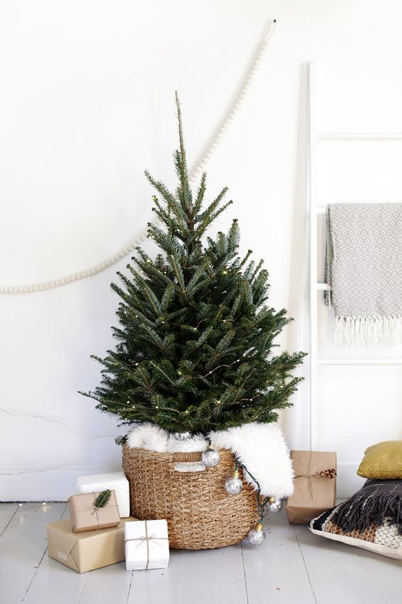 a tree in a basket covered with faux fur is a great idea