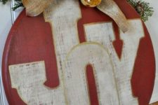 17 red ornament JOY sign with gold ornaments and a burlap bow