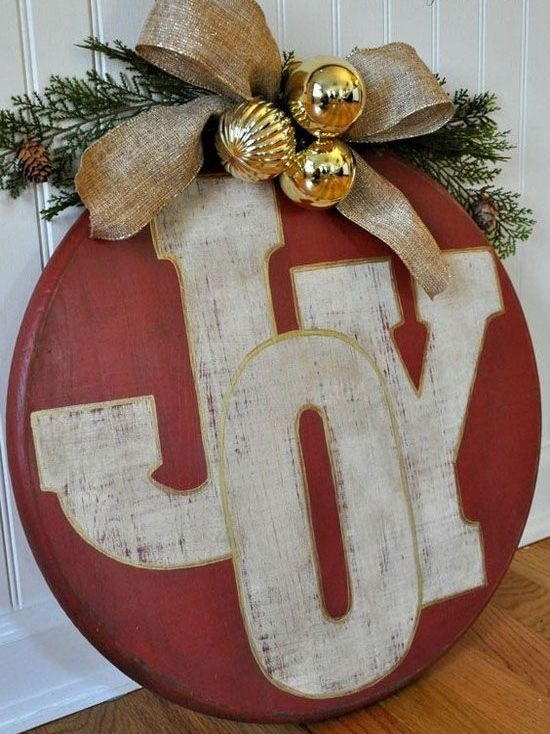 red ornament JOY sign with gold ornaments and a burlap bow