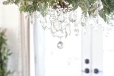 17 vintage chandelier decorated with foliage, evergreens and crystals