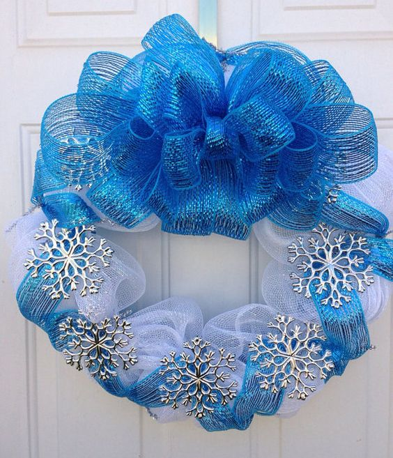 a blue and white deco mesh wreath with silver snowflakes