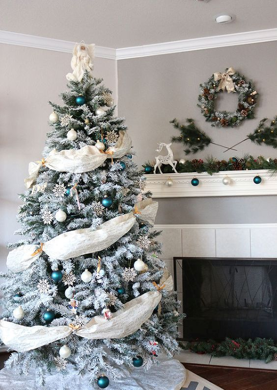emerald and white ornaments and fabric garlands look eye-catching