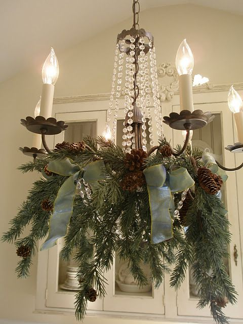 fir branches green ribbon and pinecones - How To Decorate A Chandelier For Christmas