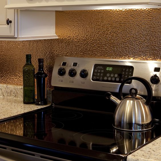 hammered and polished copper metal backsplash