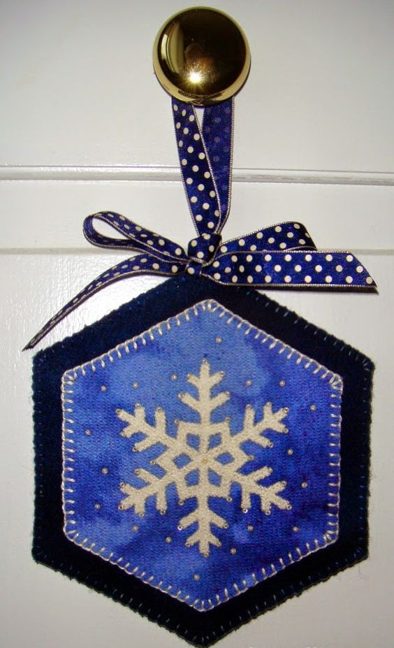 stitched wool door hanger with a snowflake