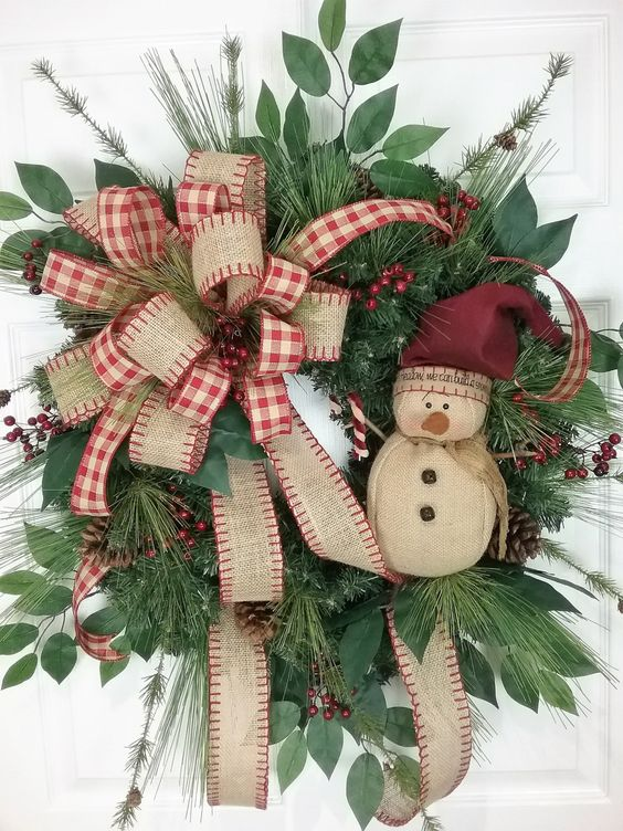 vintage-inspired wreath with a burlap bow and a snowman