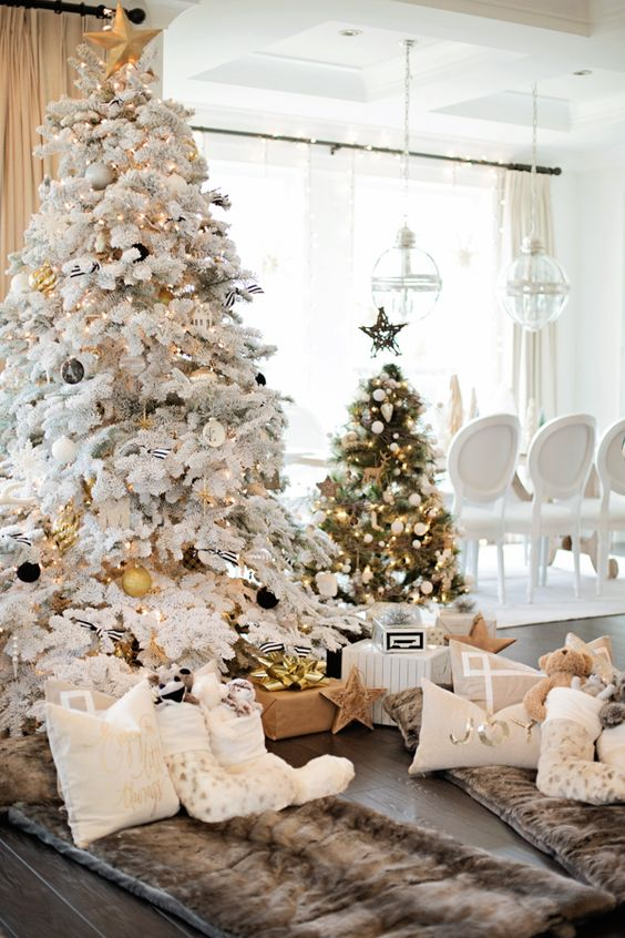 flocked tree with black and gold ornaments