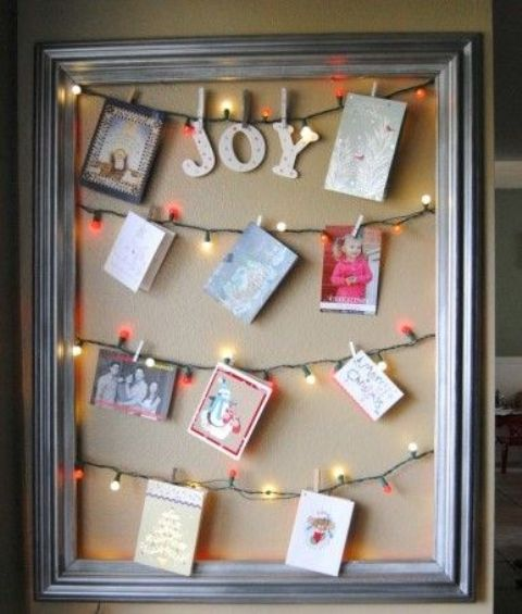 hang the cards right on the light garlands in a frame