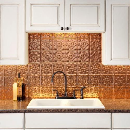 intricate fretwork patterns for a chic Moroccan inspired look and plain white cabinetry look refined