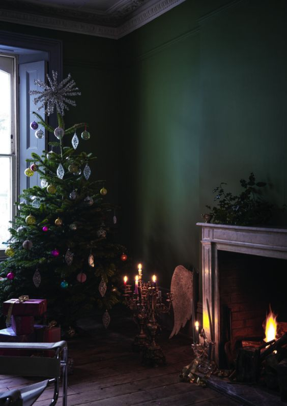 moody Christmas decor with bold vintage ornaments and a working fireplace
