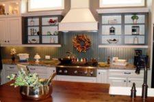 19 slate blue beadboard backsplash contrasts with white cabinets