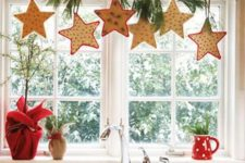 20 Christmas star-shaped cookies hanging from a branch