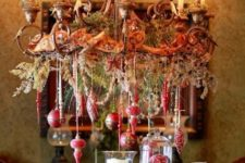 20 beautiful Christmas chandelier with hanging red ornaments, vintage ribbon and evergreens