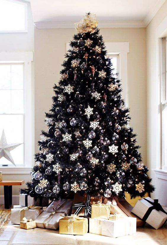 chic black christmas tree with black and white ornaments all over makes a bold statement