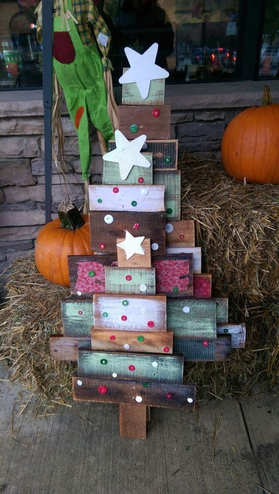 colorful reclaimed wood Christmas trees with button decor