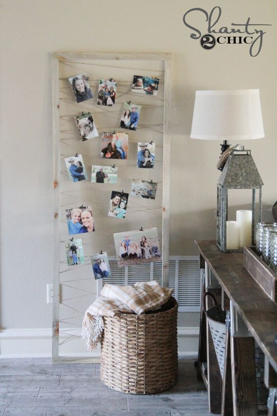 hang threads in a frame and attach pictures and cards inside
