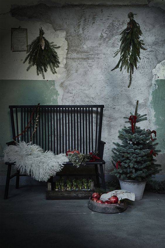 moody industrial space with evergreens, fur and pomegranates