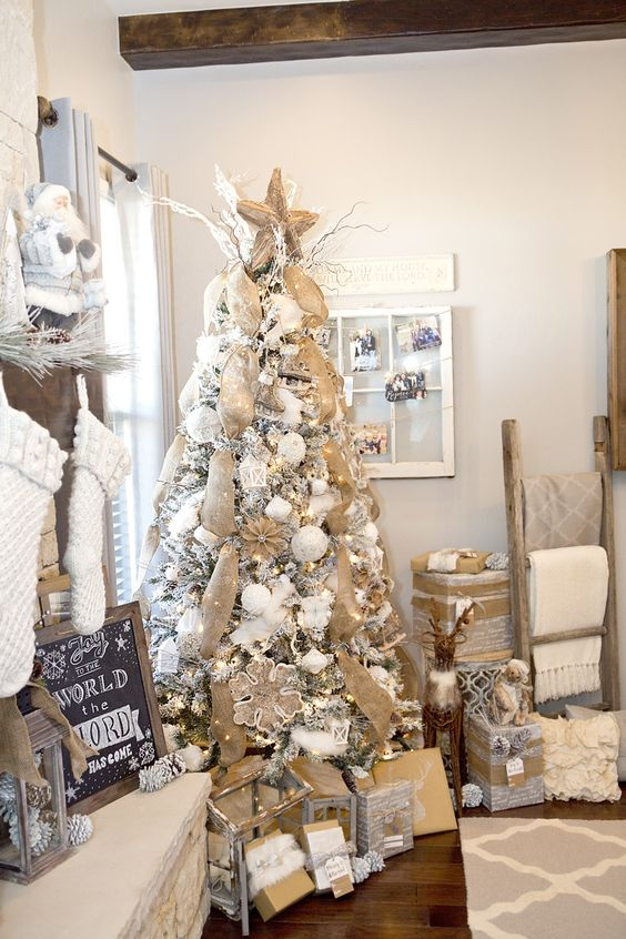 neutral and rustic flocked Christmas tree decor with burlap mesh