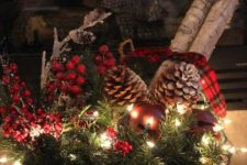 21 a basket with evergreens, berries, pinecones and lights