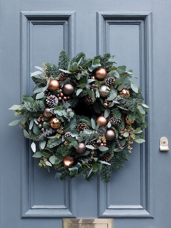 beautiful copper and mink baubles, frosted pine cones and miniature copper bells for the wreath