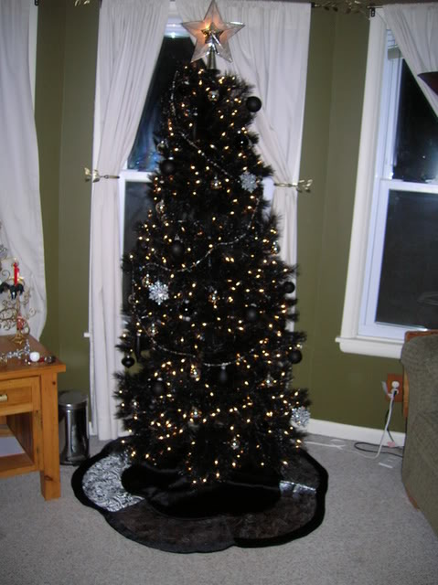 chic black tree with black ornaments and gold lights