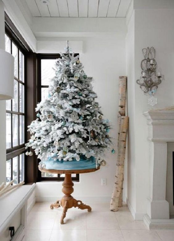 icy blue and gold ornaments for decorating a tree
