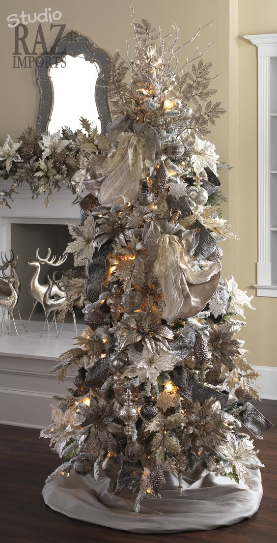 21 unique silver and white christmas tree made of ornaments and decorations