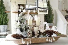 22 a dough bowl with pinecones, candles and vintage ornaments