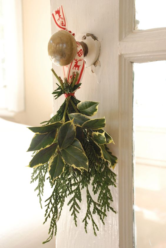 fresh greenery wreath with Scandinavian ribbon