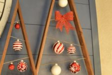 22 reclaimed wood plank christmas trees with ornaments hanging inside