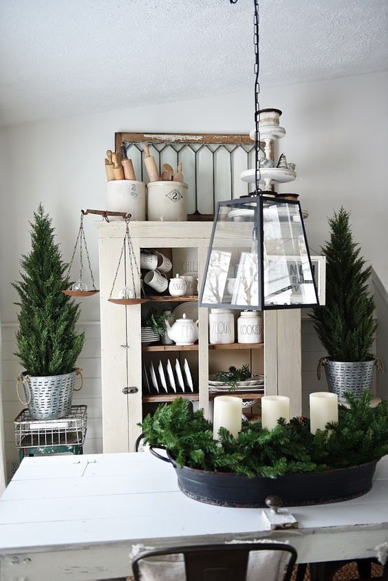decorate your home with evergreens and candles with no other decor and keep it neutral