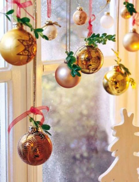gilded ornaments decorated with greenery twigs
