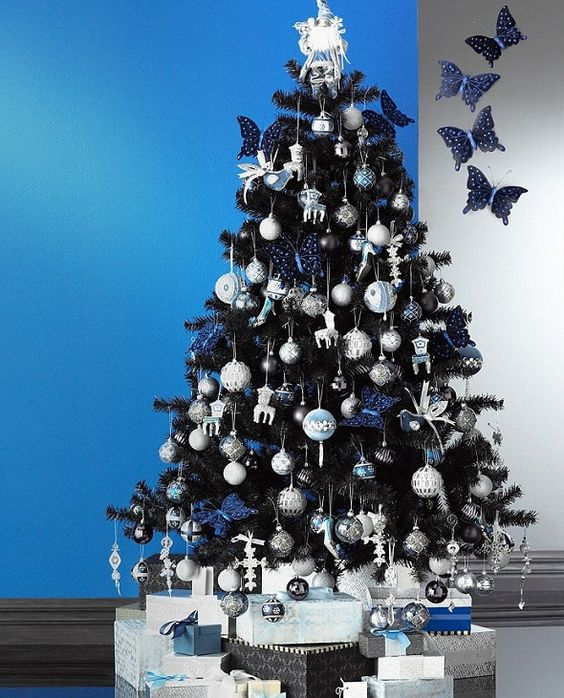 navy, white and silver ornaments look good on black trees