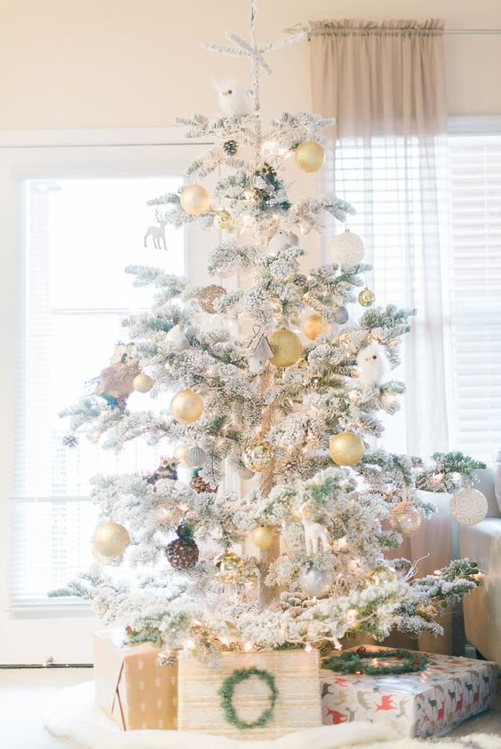 13 silver and pearl ornaments highlight the tree decor and make it amazing - Decorated Flocked Christmas Trees