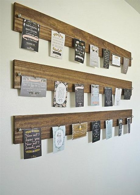 wooden planks with wire and cards attached to them
