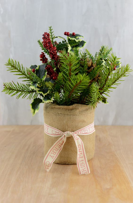 a burlap wrapped pot with evergreens, leaves and berries would be perfect addition to your Christmas staircase decor