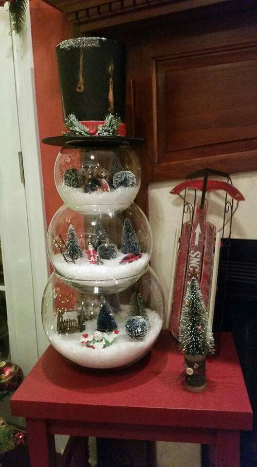 a snowman mad eof three glass terrariums filled with winter stuff is a whimsy idea