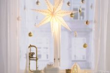 24 gold ornaments and an oversized shining star