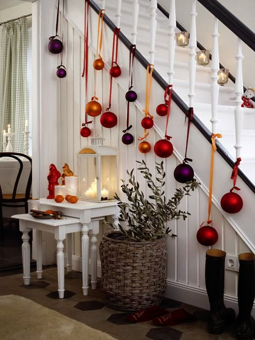 large colorful ornaments hanging from the staircase