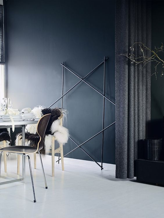 moody interior and a twig star in black as a decoration