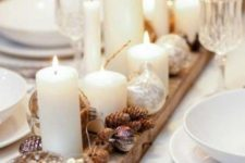 24 place a wooden plank on the table, cover it with pinecones and candles